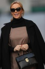 Amanda Holden Pictured at Heart radio in patterned dress and boots in London