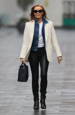 Amanda Holden Wears leather trousers and white top at Heart radio in London