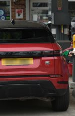 Amy Hart Stops to refuel her new Range Rover at a local petrol station in Worthing