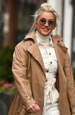 Ashley Roberts Stuns in white jumpsuit and roll neck jumper at Heart radio in London