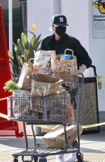 Charlize Theron Sports an all-black gym attire as she stops by Bristol Farms for groceries in Beverly Hills