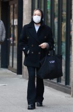 Chloe Sevigny Looks stylish in black while waving to the camera after shopping at a Soho supermarket