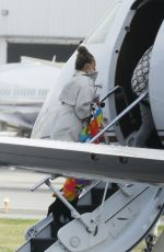 Chrissy Teigen Pictured boarding a private jet this afternoon in Los Angeles