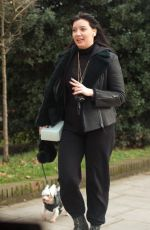 Daisy Lowe All smiles as she took her cute pet dog for a walk the day after she celebrated her 32nd birthday in North London
