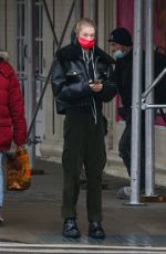 Hunter Schafer Takes a walk as she checks her messages on her phone in New York City