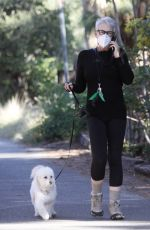 Jamie Lee Curtis Walks her adopted pooch Runi, a poodle-terrier mix, in Santa Monica canyon
