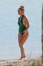 Jennifer Lopez In green swimsuit on the beach in Turks and Caicos