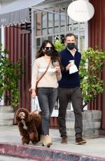 Jordana Brewster Picks up coffee with her boyfriend while taking her dog on a walk in Brentwood