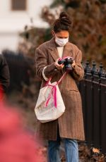 Katie Holmes Shows off her photography skills on a trip to Washington Square Park in New York