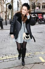 Kelly Brook In Mini dress and boots outside Heart Radio in London