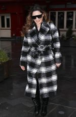Kelly Brook Looks sensational in a checked coat and boots flashing her legs outside the Heart Radio Studios in London