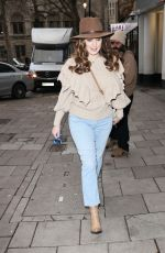 Kelly Brook Wears a cowboy hat and rocks in denim jeans at the Heart Radio Studios in London