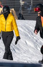 Kendall Jenner Steps out to shred the slopes of Buttermilk in a ticket-me-yellow Prada jacket and black Prada trousers in Aspen