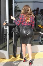 Khloe Kardashian In a tight leather skirt while taping KUWTK in Los Angeles