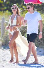 Kimberley Garner All in white scantly clad at a beach in Miami