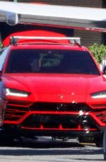 Kylie Jenner Pulls up to her private jet in a red Lamborghini in Los Angeles