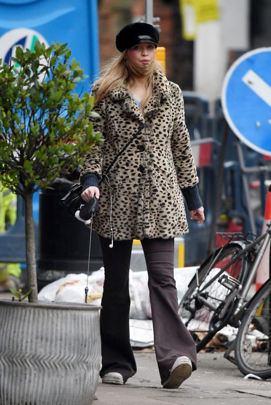 Laura Whitmore Out walking her dog in London
