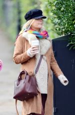 Laura Whitmore Shows her growing baby bump while out with a friend in London