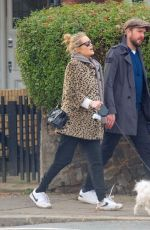 Laura Whitmore Takes a romantic walk hand-in-hand with new husband Iain Stirling in London