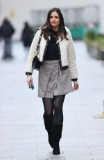 Lilah Parsons In Mini skirt and boots out in London