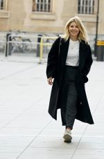 Mollie King Flashes her dazzling engagement ring and is full of smiles as she arrives at BBC Radio One Studios in London
