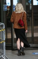 Mollie King Is full smiles as she arrives back at BBC Radio One Studios after the Xmas in London