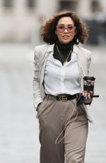 Myleene Klass Looks chic in casuals beige trousers, white blouse and turtle neck jumper at Smooth radio in London