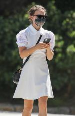 Natalie Portman Wearing a lovely white dress while she and her daughter visit a nail salon in Sydney