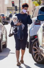 Nicole Murphy Leaves a medical building in Los Angeles with her dog in her arms
