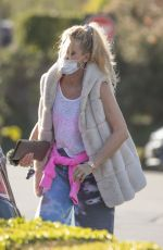 Nicollette Sheridan Was caught dancing behind her Maybach in a parking lot in Calabasas