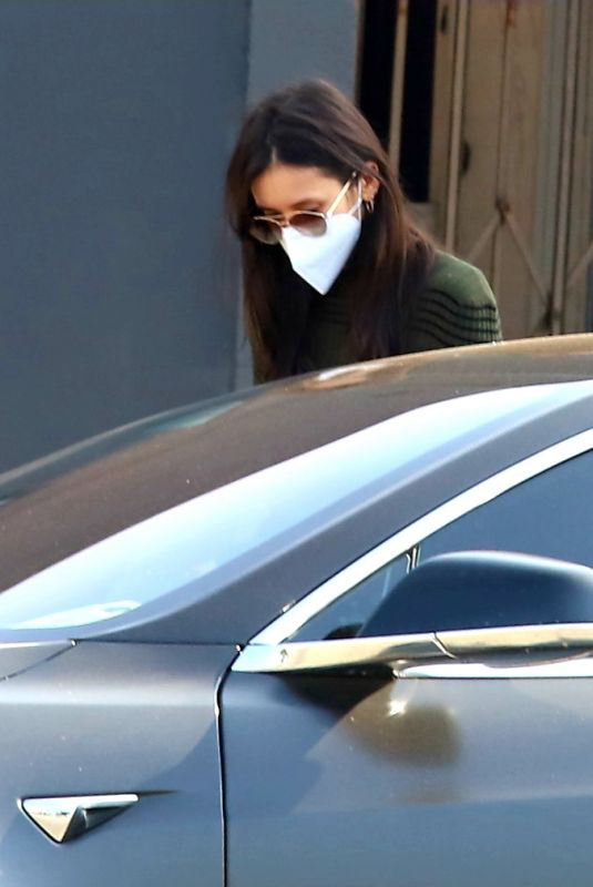 Nina Dobrev Seen with mystery man who gets in the driver seat of her car after shopping a design store in West Hollywood