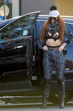 Phoebe Price Goes shopping with her dog on Melrose Ave in West Hollywood