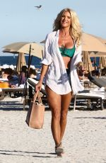 Victoria Silvstedt Shows off her tan figure in a sexy green bikini as she relaxes on the beach in Miami Beach