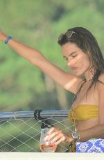 Alessandra Ambrosio Turns heads as she enjoys a day on a luxury yacht with friends in Florianopolis in Brazil