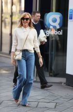 Amanda Holden Steps out in flared denim and cream top in London