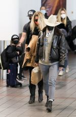 Amber Heard Makes a low-key arrival with her girlfriend Bianca Butti at LAX airport in Los Angeles