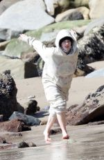 Billie Eilish Seen with her dog on the beach in Malibu