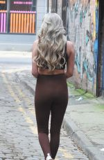 Chloe Crowhurst Puts on a busty display as she flashes her abs during walk around Manchester City Centre