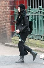 Daisy Lowe Wearing her cozy fur-lined leather jacket as she gets caught in a heavy downpour during the COVID-19 lockdown in London