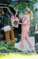 Emma Roberts Greets a friend who pays her a visit at her home in Los Angeles