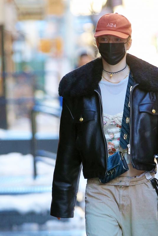 Hunter Schafer Returns to her hotel after a shopping trip in Soho