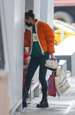 Irina Shayk Has her hands full while out in snowy New York