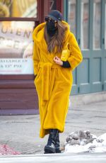 Irina Shayk Looks stunning in a yellow long puffy coat while out for a stroll in New York