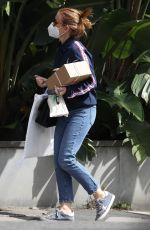 Isla Fisher Pictured indulging in some retail therapy on the eve of her 45th birthday while pictured out in Sydney