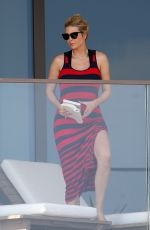 Ivanka Trump Wears a red and black striped dress as she has lunch on her balcony in Miami