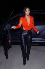 Kim Kardashian Wearing a fiery orange cut-out bodysuit with a plunging neckline, black leather pants and stilettos in Calabasas