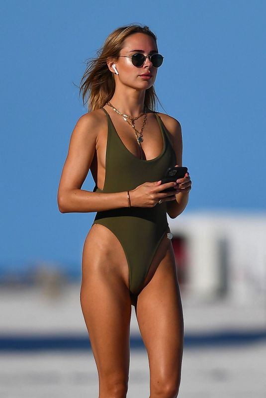 Kimberley Garner In Green swimsuit at the beach in Miami