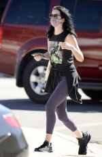 Krysten Ritter Shops for a dress after hitting the gym in purple leggings in Los Angeles