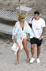 Laeticia Hallyday & Jalil Lespert Seen on the beach in St. Barths