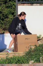 Lucy Hale Gets some packages at her home in LA